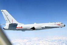 中国空军轰-6K与苏-30巡航黄岩岛 预警机首次伴随