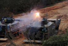 世界最快两栖战车展露强劲火力:我陆战队千里机动