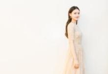 林允亮相北京电影节闭幕式 槟色长裙优雅气质
